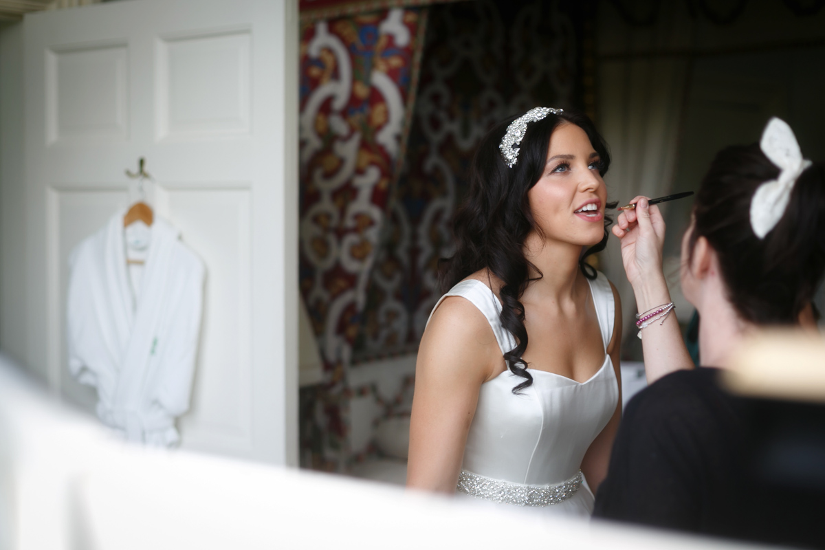 bride with makeup artist at leeds castle