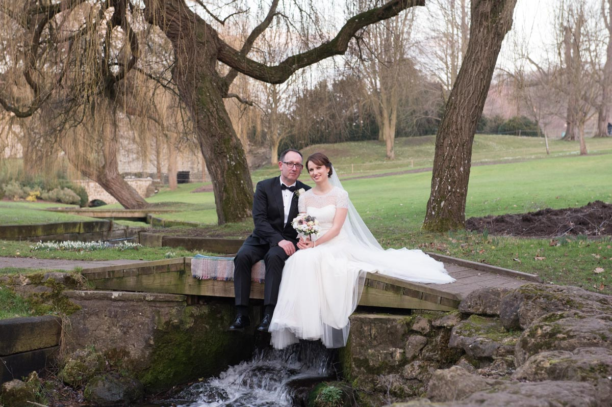bride and groom at lake at leeds castle, maidstone, kent
