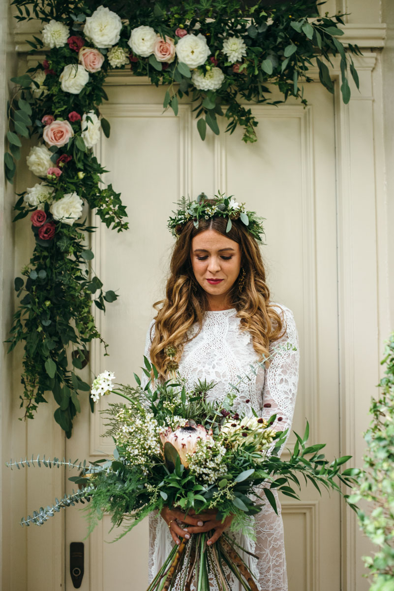 bride boho hair and makeup plus flower bouquets