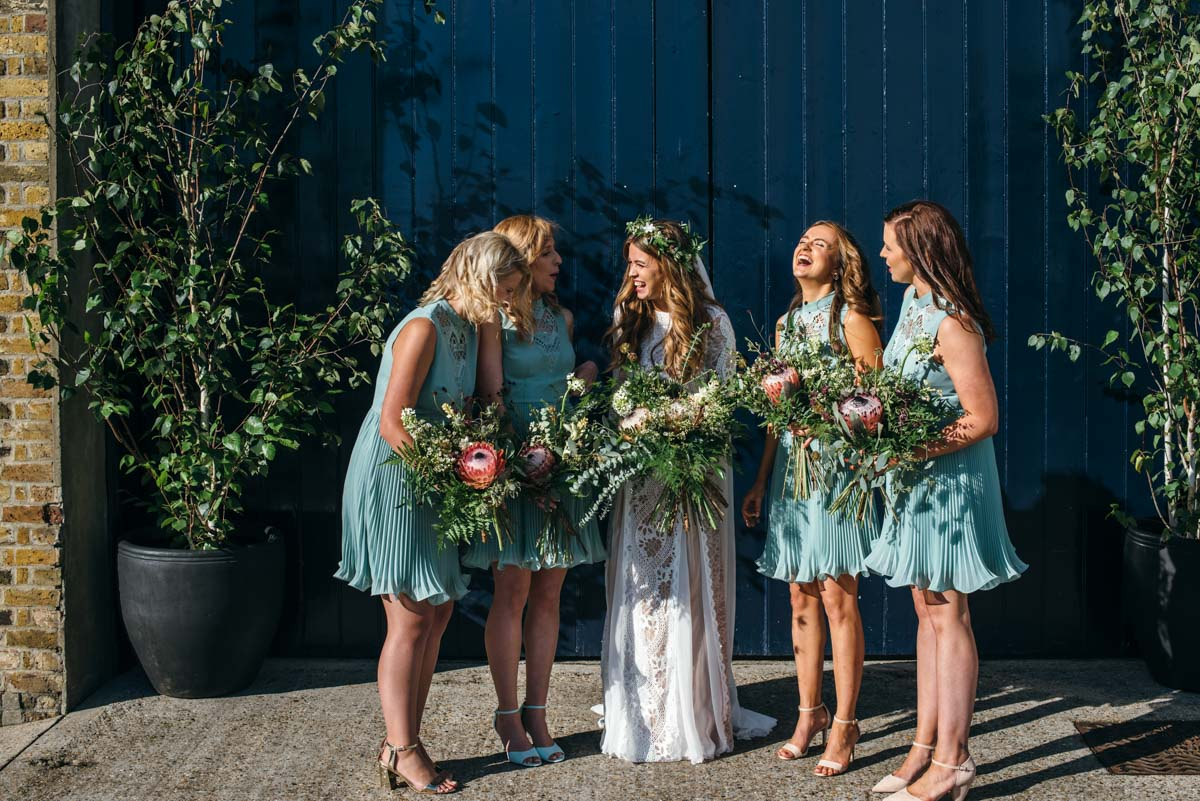 bride and bridesmaids at butlers wharf in london on wedding day