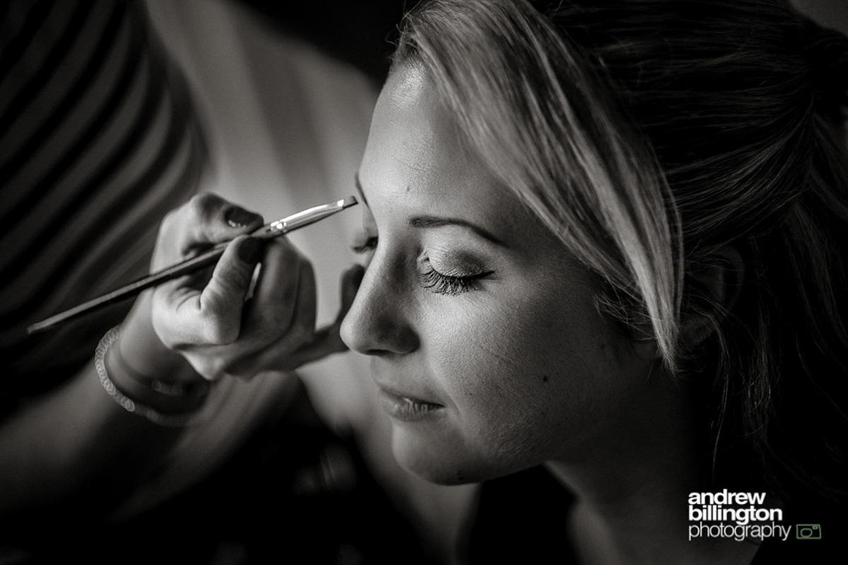 bride with makeup artists at leeds castle, kent