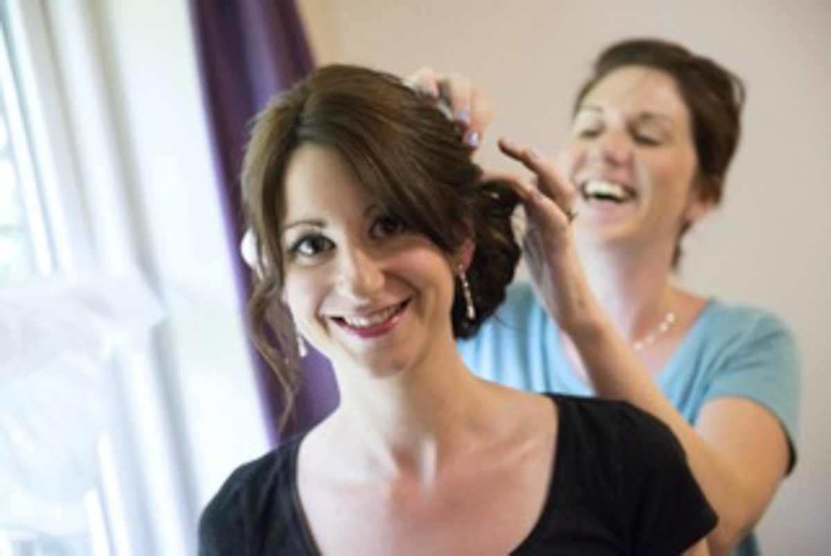 bride and hairstylist on her wedding day
