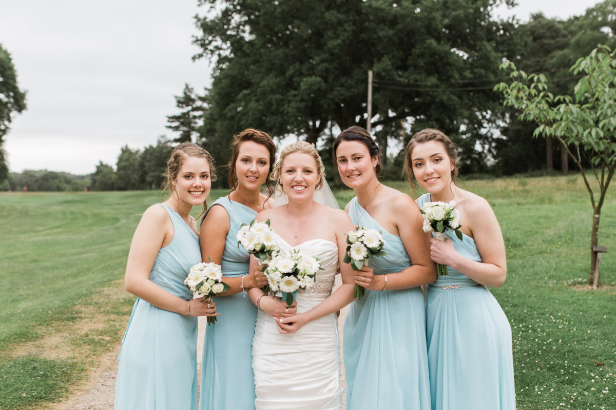 bride and bridesmaids hair and makeup on her wedding day at cottlesmore gold club