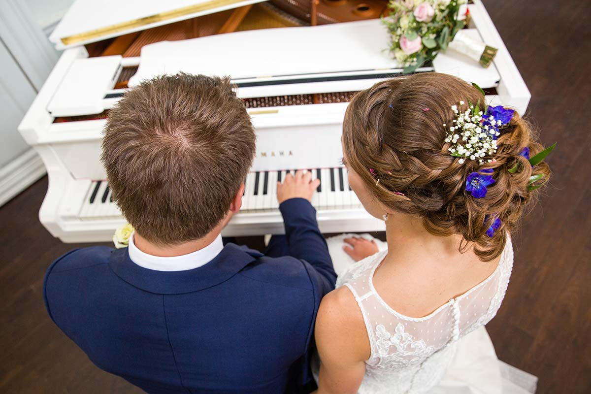 wedding day bride and groom playing piano morden, london