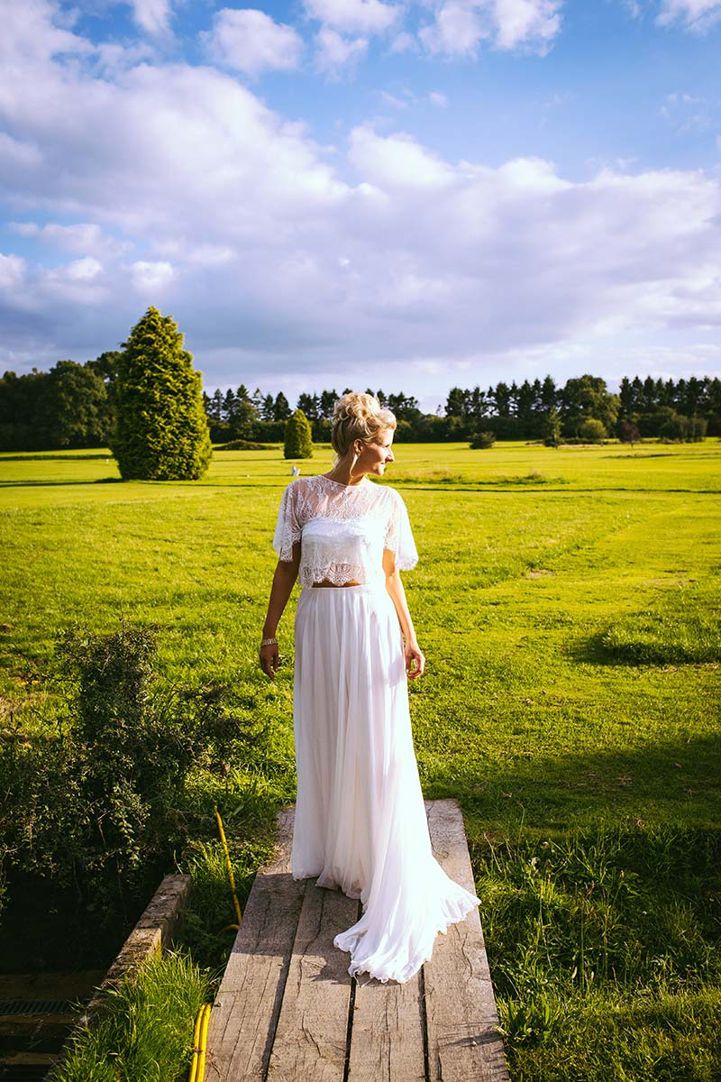 bride in field at brookfield barn, east sussex
